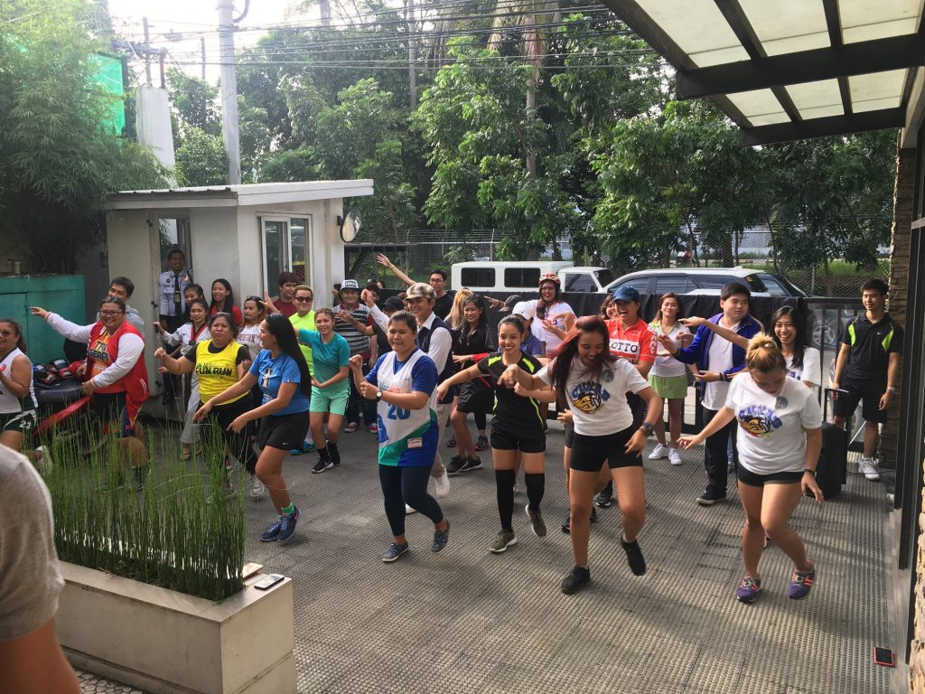 Employees do zumba as part of FilWeb Asia in 2018 events